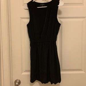 Mini black dress with open back